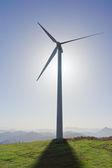 Wind turbine with shadow — Stock Photo