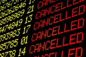 Cancelled flights on airport board — Stock Photo