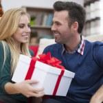 Couple getting Christmas presents — Stock Photo #52119593