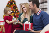 Mother receive Christmas present — Stock Photo