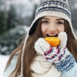 Woman eating orange — Stock Photo #52436661