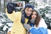 Loving couple making selfie — Stock Photo