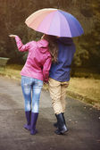 Loving couple with umbrella — Stock Photo
