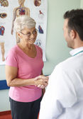 Mature woman Visits doctor — Stock Photo