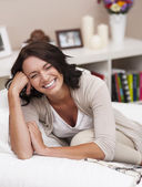 Laughing woman in interior — Stock Photo