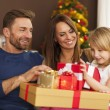 Happy family with christmas gifts — Stock Photo #55949897