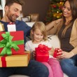 Family opening christmas presents — Stock Photo #55950223