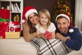 Happy family with christmas gifts — Stock Photo