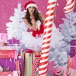 Sexy santa claus with christmas candy cane — Stock Photo #56903097
