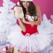 Lovely female santa claus with christmas present — Zdjęcie stockowe #56901879