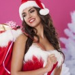 Beautiful santa claus with christmas presents — Stock Photo #56905323