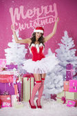 Girl holding  Merry Christmas for everyone sign — Stock Photo