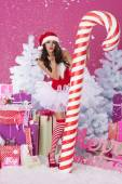 Sexy santa claus with christmas candy cane — Stock Photo