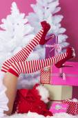 Legs of sexy santa claus — Stock Photo