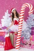 Hot female santa claus blowing a kisses — Stock Photo