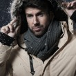 Handsome man in snow storm — Stock Photo #57292011