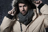 Handsome man in snow storm — 图库照片