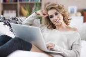 Woman in bed with laptop — Stock Photo