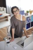 Young woman working at home — Stock Photo