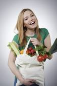 Woman with basket full of healthy food — Stock Photo