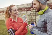 Fitness couple together outdoors — Stock Photo