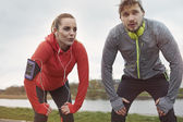 Fitness couple together outdoors — Stock fotografie