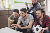 Men watching soccer match — Stock Photo