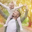 Father and daughter in park — Stock Photo #75662753