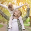 Father and daughter in park — Stock Photo #75663721
