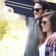 Couple in love  walking in park with skate — Stock Photo #75669011