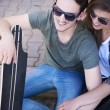 Couple in love  with skate in sunglasses — Stock Photo #75669015