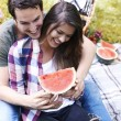 Couple in love with watermelon laughing — Stock Photo #75669407