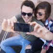 Young couple taking selfie — Stock Photo #75669621