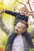 Young family in park with son — Stock Photo