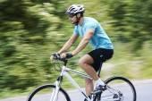 Young man on bicycle riding — Zdjęcie stockowe