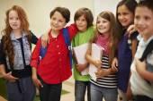 Little children standing in school — Stock Photo