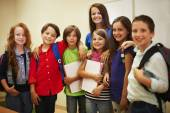 Group of teacher with her pupils. — Stock Photo