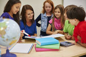 Teacher and pupils checking the homework — Stock Photo