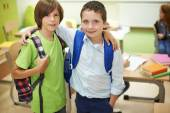 Two male pupils standing together. — Stock Photo
