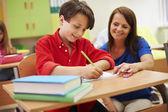 Teacher helping her pupil — Stock Photo