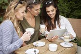 Women spending time together with laptop — Stock Photo