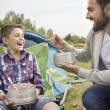 Father and son with fresh-soup — Stock Photo #79477090