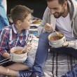 Father and son with fresh-soup — Stock Photo #79478180
