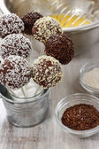 Chocolate cake pops in silver bucket — Zdjęcie stockowe