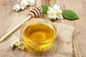 Jasmine honey on wooden table — Foto Stock
