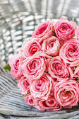 Pink roses in wicker basket — Stock Photo