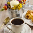 Breakfast table: cup of coffee and buns with chocolate — Stock Photo #59856281