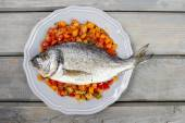 Top view of gilt-head bream fish on wooden background. — Stock Photo