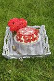 Strawberry cake on cake stand — Stock Photo