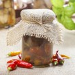 Glass jar of pickled mushrooms on jute table cloth — Stock Photo #59940251